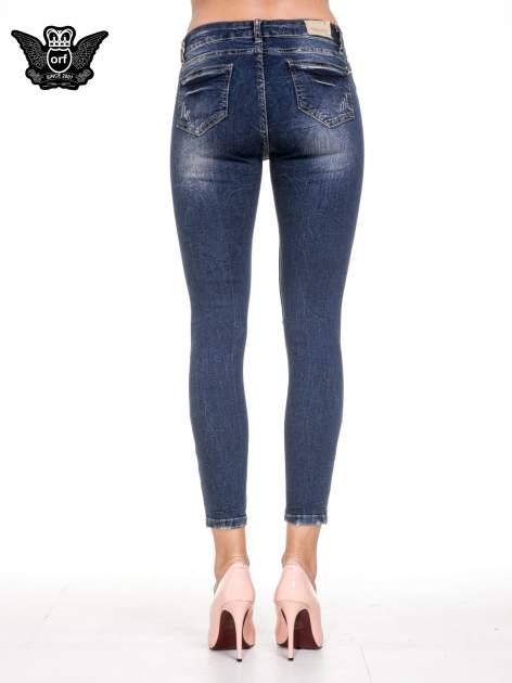 Ciemnoniebieskie spodnie skinny jeans z dziurami i zamkami                                  zdj.                                  5