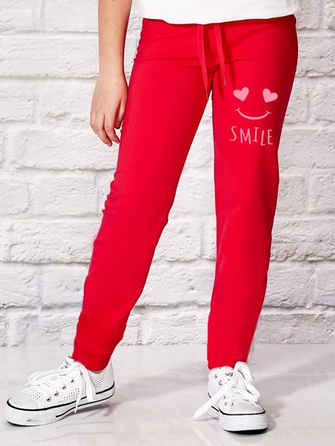 Ciemnoróżowe spodnie dresowe dla dziewczynki SMILE                                  zdj.                                  1