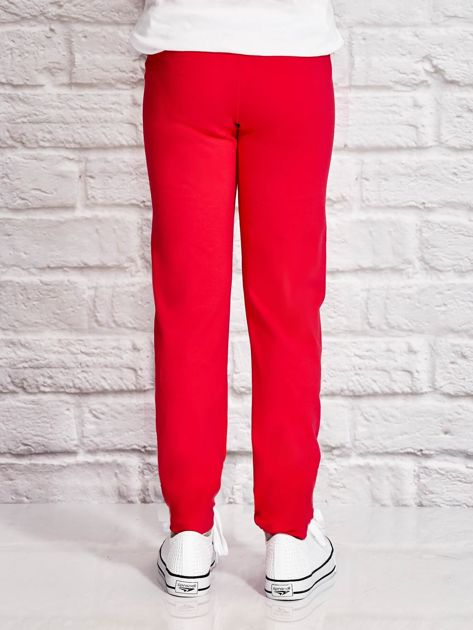 Ciemnoróżowe spodnie dresowe dla dziewczynki z napisem FOLLOW MY FEET                              zdj.                              3