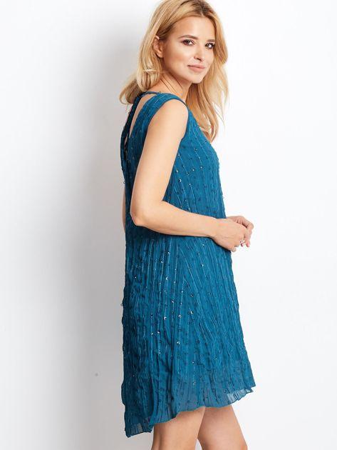 Ciemnoturkusowa sukienka z cekinami i wiązaniem z tyłu                                  zdj.                                  2