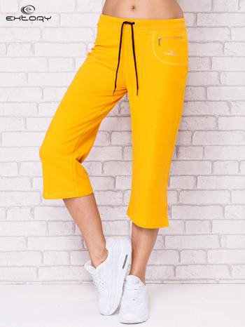 Ciemnożółte spodnie sportowe capri                                  zdj.                                  1