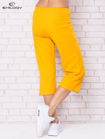 Ciemnożółte spodnie sportowe capri                                  zdj.                                  2