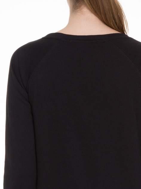 Czarna bluza z reglanowymi rękawami i napisem NYFTW                                  zdj.                                  5