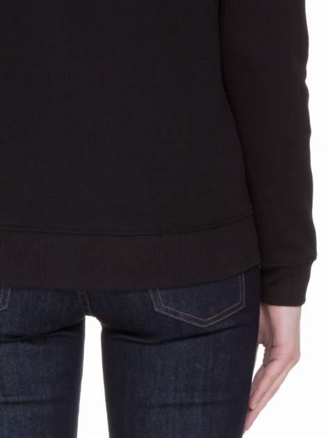 Czarna bluza z reglanowymi rękawami i napisem NYFTW                                  zdj.                                  6