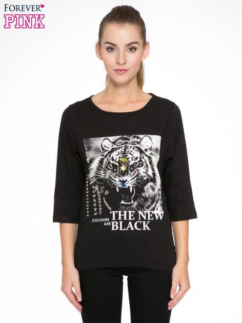 Czarna bluzka z nadrukiem tygrysa i napisem THE NEW COLOURS ARE BLACK