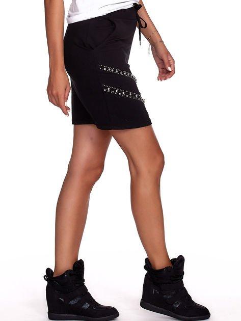 Czarna dresowa spódnica z kieszeniami i perełkami                              zdj.                              6