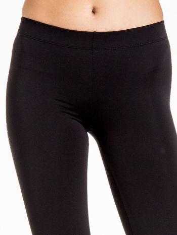 Czarna legginsy z dżetami wzdłuż nogawki                                  zdj.                                  6
