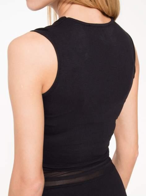Czarna sukienka tuba z tiulowymi wycięciami                                  zdj.                                  9