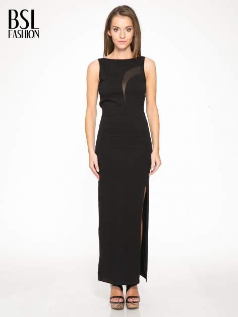 Czarna wieczorowa sukienka maxi z transparentną wstawką i dekoltem a plecach