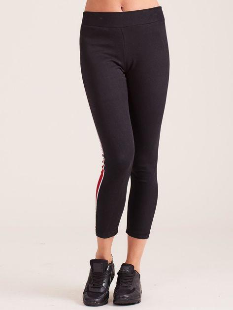 Czarne damskie legginsy z lampasami                              zdj.                              2