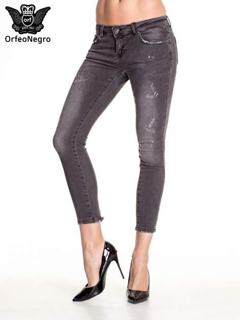 Czarne dopasowane spodnie skinny jeans z przetarciami i zamkami na dole                                  zdj.                                  1