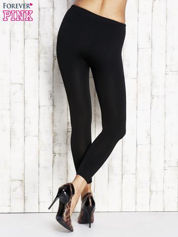 Czarne gładkie ocieplane legginsy                                  zdj.                                  3