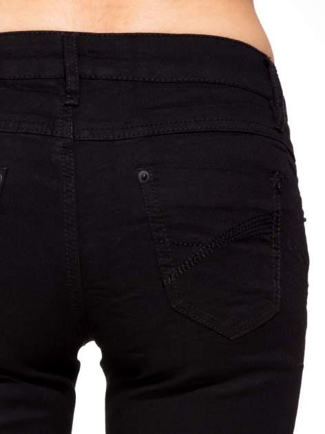 Czarne klasyczne spodnie jeansowe rurki                                  zdj.                                  7