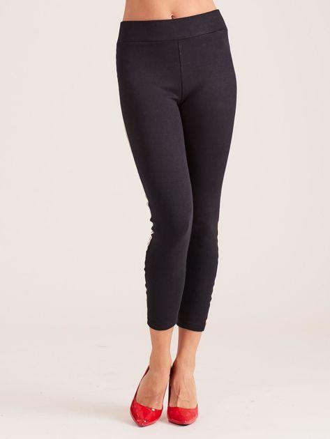 Czarne legginsy damskie z lampasami                              zdj.                              2