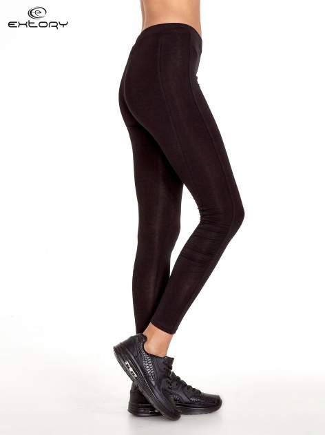 Czarne legginsy sportowe z drapowaniem                                  zdj.                                  2