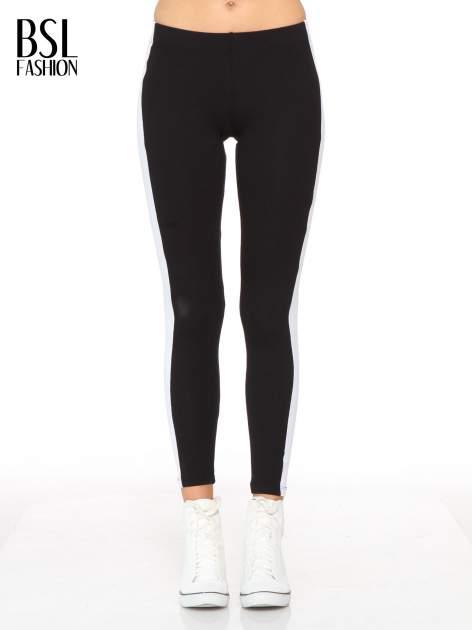 Czarne legginsy z białymi modułami wzdłuż nogawek                                  zdj.                                  1