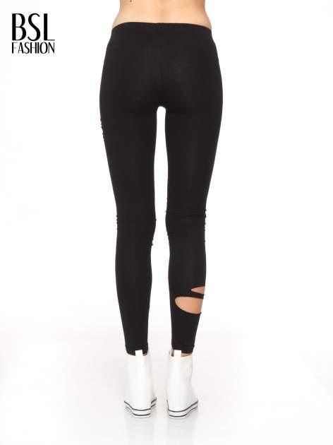 Czarne legginsy z dziurami                                  zdj.                                  4