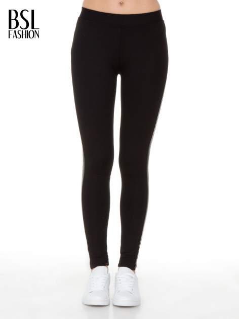 Czarne legginsy z lamapasami ze skóry