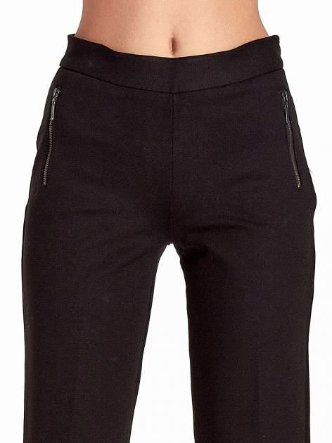 Czarne materiałowe spodnie dzwony w kant                                  zdj.                                  6
