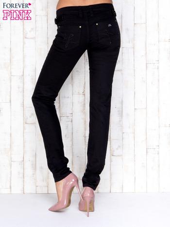 Czarne przecierane spodnie jeansowe regular jeans                                  zdj.                                  3