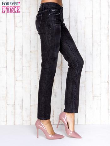 Czarne przecierane spodnie jeansowe ze srebrną nitką                                  zdj.                                  3