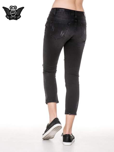 Czarne rozjaśniane spodnie jeansowe 7/8 z rozdarciami                                  zdj.                                  2