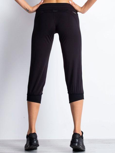 Czarne spodnie capri z troczkami                                  zdj.                                  2