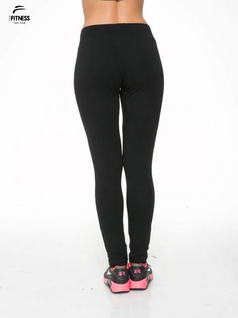 Czarne spodnie dresowe z kieszeniami na zamek                                  zdj.                                  4