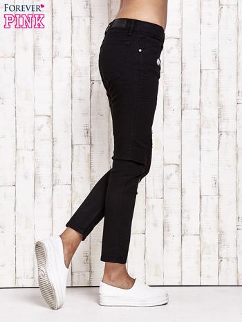 Czarne spodnie rurki z naszywkami                                  zdj.                                  2