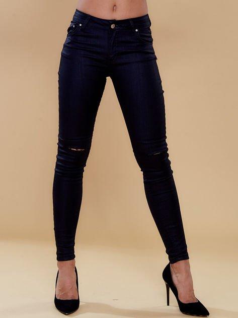 Czarne spodnie skinny z dziurami                              zdj.                              1