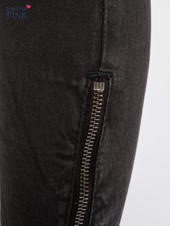 Czarne spodnie typu rurki z suwakami wzdłuż nogawek i z przodu                                  zdj.                                  5