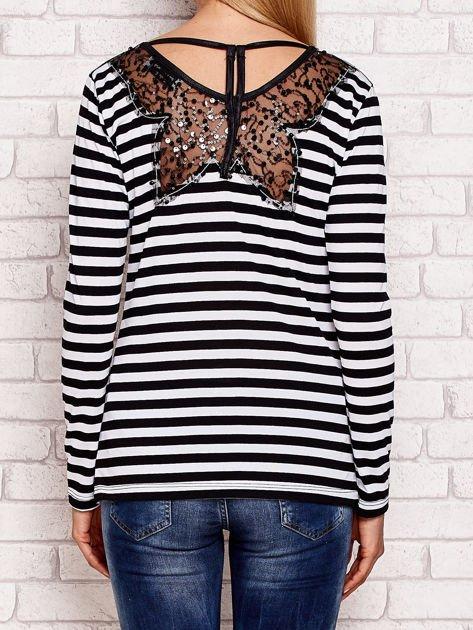 Czarno-biała bluzka w paski z cekinowymi motywami                              zdj.                              2