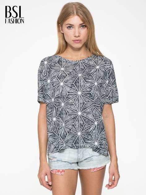 Czarny t-shirt z geometrycznym nadrukiem roślinnym                                  zdj.                                  1