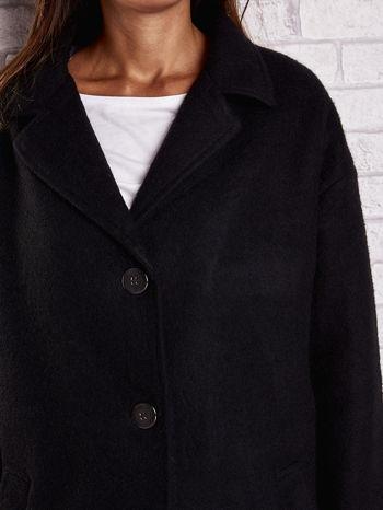 Czarny wełniany płaszcz z kieszeniami i kołnierzem                                  zdj.                                  7