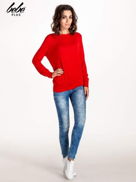 Czerwony sweter z kokardą na plecach                                  zdj.                                  2