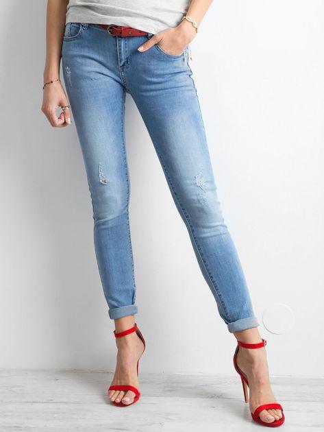 Damskie jeansy z przetarciami niebieskie                              zdj.                              1