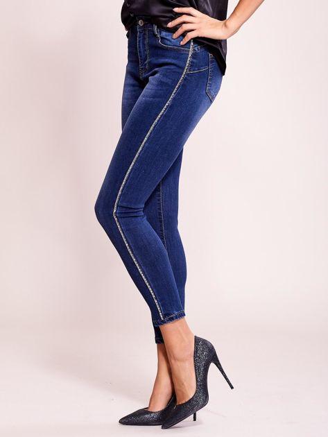 Dopasowane spodnie jeansowe z aplikacją ciemnoniebieskie                              zdj.                              3