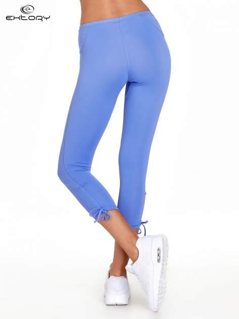 Fioletowe legginsy sportowe termalne z dżetami i ściągaczem                                  zdj.                                  2