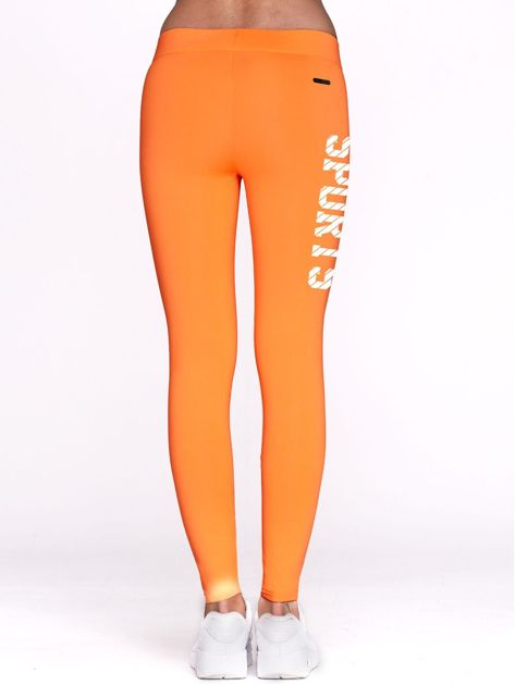 Fluo pomarańczowe legginsy do fitnessu ze sportowym nadrukiem                                  zdj.                                  3