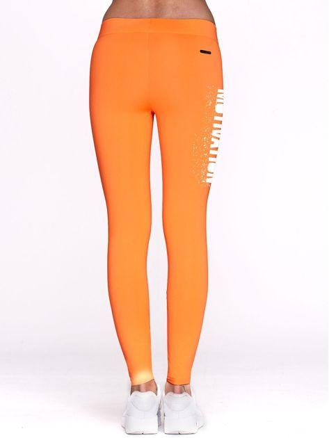 Fluo pomarańczowe legginsy na siłownię z motywującym hasłem                                  zdj.                                  3