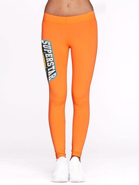 Fluo pomarańczowe legginsy sportowe z nadrukiem SUPERSTAR                              zdj.                              2