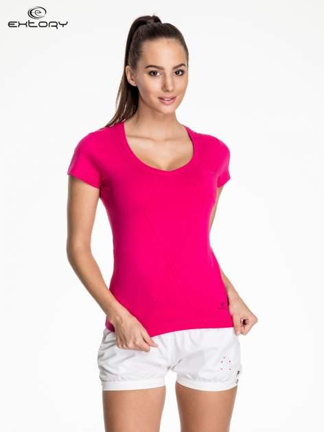 Fuksjowy modelujący damski t-shirt sportowy