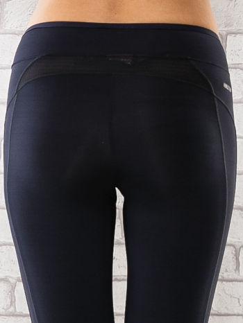 Granatowe legginsy 3/4 sportowe termalne z lampasami                                  zdj.                                  6