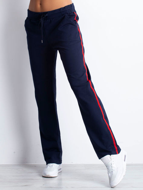 Granatowe spodnie dresowe z lampasami                              zdj.                              5