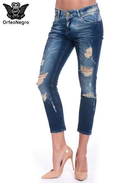 Granatowe spodnie skinny jeans z dziurami                                  zdj.                                  1