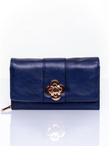 Granatowy portfel z ozdobnym zapięciem                                  zdj.                                  1