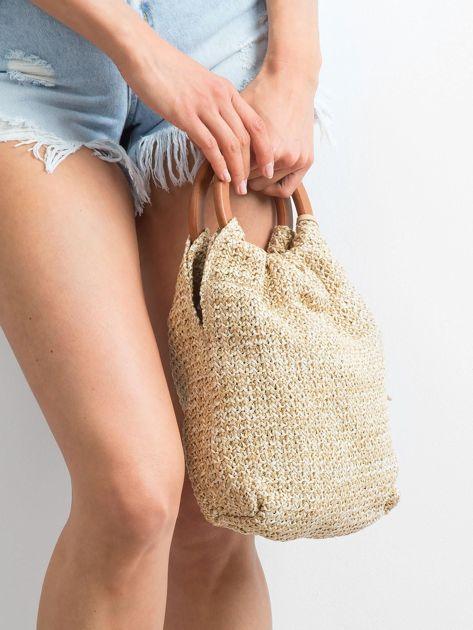 Jasnobeżowa mała torebka pleciona do ręki                              zdj.                              2