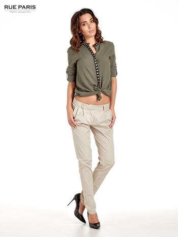 Jasnobeżowe spodnie cygaretki z zakładkami                                  zdj.                                  8