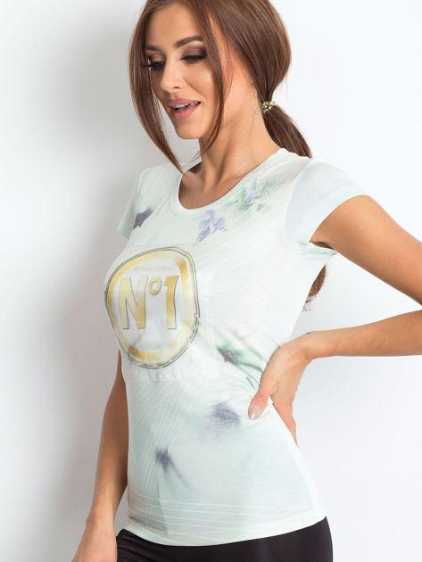 Jasnomiętowy t-shirt z graficznym nadrukiem                              zdj.                              2