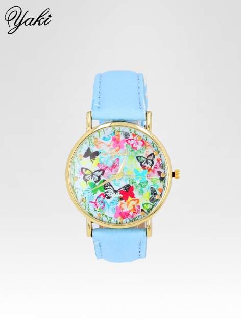 Jasnoniebieski zegarek damski na pasku z kwiatową tarczą